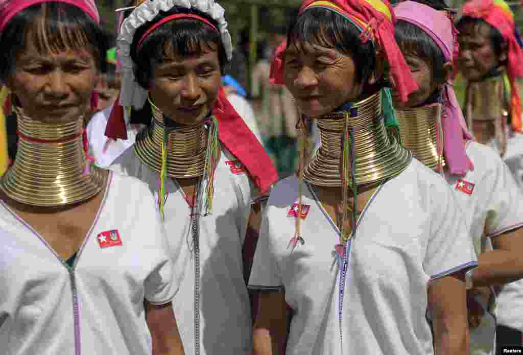 Ethnic Kayan women wait for Myanmar pro-democracy leader Aung San Suu Kyi's speech during her campaign for the upcoming general election, in Demoso, Kayah state.