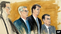 FILE - In this courtroom sketch, Alejandro Burzaco, second from right, stands with his attorneys Sean Casey, second from left, and John Couriel, right, and prosecutor Samuel Nitze, left, July 31, 2015 in federal court in New York.