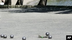 Petanque is a game played between two teams of three players of which the aim is to get your teams ball closest to the 2.5 centimeter (one inch) jack ball with the first team to 13 points being the winner.