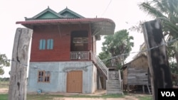 This newly built home belongs to Phel Hoeun's younger brother, who is migrating to work in Thailand, in order to pay off the loan they took to build this house, in Siem Reap province, August 2, 2019. (Khan Sokummono/VOA Khmer)