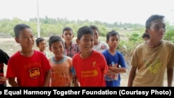 Acehnese boys visiting Aceh Utara camp.