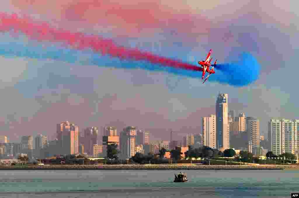 "The British Royal Air Force's (RAF) aerobatic team, the ""Red Arrows"", performs aerial maneuvers during an airshow in Kuwait City."