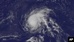 FILE - Satellite image released by the US National Oceanic and Atmospheric Administration, shows Hurricane Danny over the Atlantic Ocean, Aug. 21, 2015.