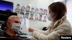 A software engineer works on a facial recognition system that identifies people when they wear a face mask at the development lab of the Chinese electronics manufacturer Hanwang (Hanvon) Technology in Beijing.