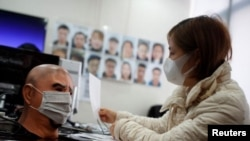 A software engineer tests a facial recognition program that identifies people when they wear a face mask at the development lab of the Chinese electronics manufacturer Hanwang Technology in Beijing as the country is hit by an outbreak of the novel coronav