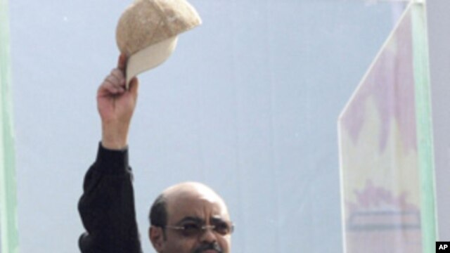 Meles Zenawi gestures to Ethiopians gathering at Meskel Square in Addis Ababa, Ethiopia, Saturday, May 28, 2011