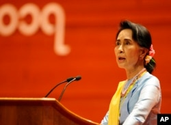FILE - Myanmar's State Counsellor Aung San Suu Kyi speaks during the opening ceremony of the second session of the 21st Century Panglong Union Peace Conference at the Myanmar International Convention Centre in Naypyitaw, Myanmar, May 24, 2017.