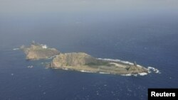 Handout photograph shows the disputed islets, known as Senkaku in Japan and Diaoyu in China, Dec. 13, 2012.