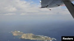 Handout photograph taken on a marine surveillance plane B-3837 shows the disputed islets, known as Senkaku in Japan and Diaoyu in China, December 13, 2012.