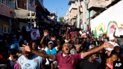 Supporters of presidential candidate Maryse Narcisse, from Fanmi Lavalas political party, chant victory slogans during a protest in Port-au-Prince, Haiti, Nov. 28, 2016.