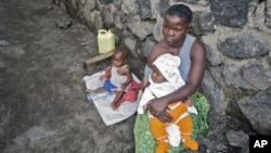A woman looks after her two babies after being abandoned by her husband for being raped, in Goma. UNICEF estimates over 1,000 women and girls are raped per month in the Democratic Republic of Congo (File)
