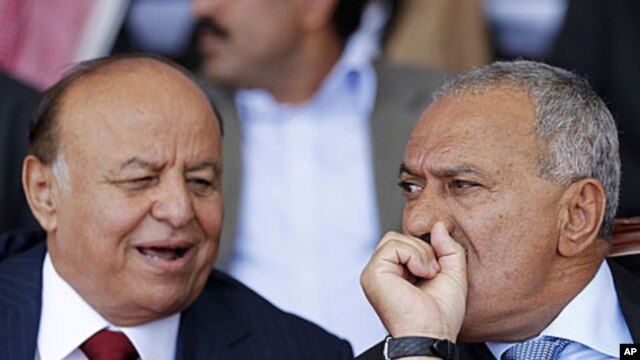 Yemen's Vice President Abed Rabo Mansour Hadi, left, pictured here with President Ali Abdullah Saleh during a gathering of Saleh's supporters in Yemen's capital Sana'a on March 10, 2011