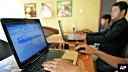Young Cambodians are surfing the internet at a local cafe shop in Phnom Penh.