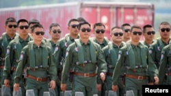 Members of Chinese People's Liberation Army (PLA) Air ForceRed Falcon aerobatic team attend the China International Aviation and Aerospace Exhibition in Guangdong province, China, Sept. 28, 2021.