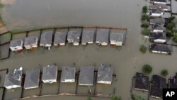 The total cost of the disaster is unclear because floodwaters are still rising, but preliminary estimates, which vary widely, run into the tens of billions of dollars.