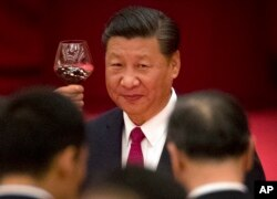 FILE - Chinese President Xi Jinping toasts during a reception at the Great Hall of the People on the eve of the Oct. 1 National Day holiday in Beijing.