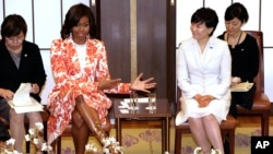 U.S. first lady Michelle Obama, center left, and Japanese counterpart Akie Abe, center right, talk with participants during the roundtable meeting as part of Japan-U.S. Joint Girls Education event at Iikura Guest House in Tokyo, March 19, 2015.