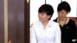 FILE - Japanese first lady Akie Abe talks with participants during a roundtable meeting as part of Japan-U.S. Joint Girls Education event at Iikura Guest House in Tokyo.