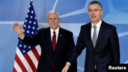 NATO Secretary-General Jens Stoltenberg welcomes U.S. Vice President Mike Pence at the NATO headquarters in Brussels, Belgium, Feb. 20, 2017.