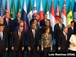 U.S. President Barack Obama, front center, joins other Group of 20 world leaders for a group photo in Antalya, Turkey, Nov. 15, 2015.