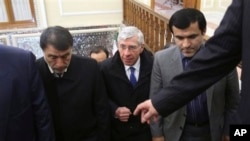 British politician Jack Straw, center, is welcomed to Iranian parliament lawmaker Abbasali Mansouri, left, Tehran, Jan. 7, 2014.