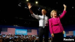 President Barack Obama waves to the crowd with Democratic presidential candidate Hillary Clinton during a Clinton presidential campaign event in Charlotte, North Carolina, July 5, 2016.