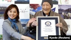 Masazo Nonaka, who was born 112 years and 259 days ago, receives a Guinness World Records certificate naming him the world's oldest man during a ceremony in Ashoro, on Japan's northern island of Hokkaido, April 10, 2018.