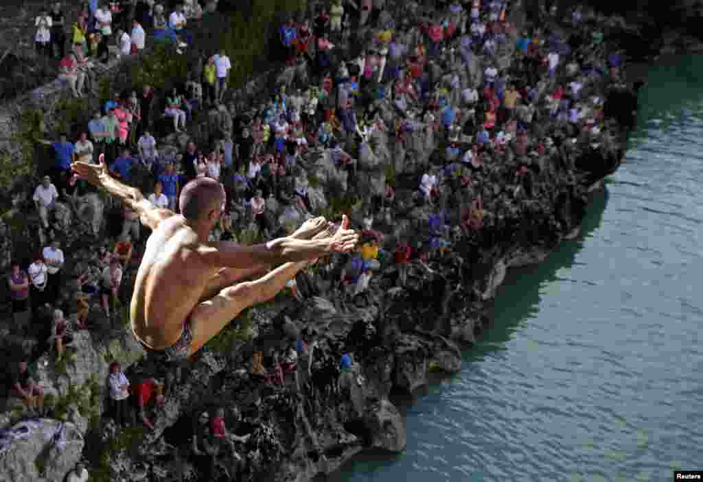 A competitor leaps up the air during a bridge jumping competition in Kanal ob Soci, Slovenia.