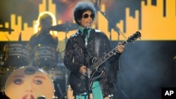 FILE - Prince performs at the Billboard Music Awards at the MGM Grand Garden Arena in Las Vegas on May 19, 2013. More than five months after Prince's fatal drug overdose, investigators are narrowing their focus.