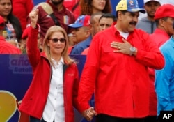 Venezuela's President Nicolas Maduro and first lady Cilia Flores acknowledge supporters at the end of a rally in Caracas, Venezuela, Feb. 2, 2019.