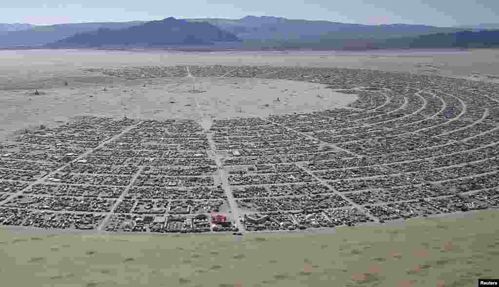 "An aerial view of the Burning Man 2014 ""Caravansary"" arts and music festival in the Black Rock Desert of Nevada, USA, Aug. 27, 2014."