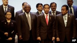 Officials are seen flanking Indonesian President Joko Widodo (2nd from right in front row), host of the Asia Africa Conference in Jakarta, Indonesia, April 21, 2015.