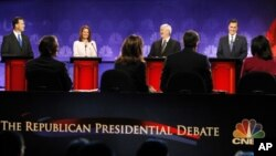 Republican presidential candidates (L-R) Rick Santorum, Michele Bachmann, Newt Gingrich and Mitt Romney take part in the CNBC Republican presidential debate in Rochester, Michigan, November 9, 2011.