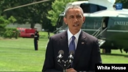 President Barack Obama makes a statement about Iraq on the White House lawn, June 13, 2014.