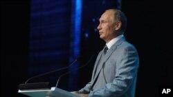 Vladimir Poutine, président de ka Russie (Mikhail Klimentyev/RIA-Novosti, Kremlin Pool Photo via AP)