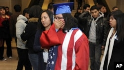 "Students, some wearing graduation caps and gowns, cry after watching from the senate gallery as opponents block passage of the ""Dream Act"" at the U.S. Capitol in Washington, D.C., 18 Dec 2010"