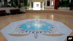 FILE - The entrance hall of Interpol's headquarters in Lyon, central France.