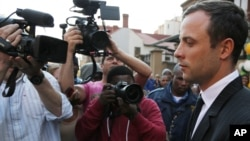 Oscar Pistorius leaves the high court in Pretoria, South Africa, Aug. 8, 2014.