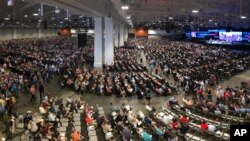 FILE - People attend the morning session of the Southern Baptist Convention annual meeting in Nashville, Tenn., June 16, 2021. Nashville health officials have linked a small coronavirus cluster to last month's SBC meeting.