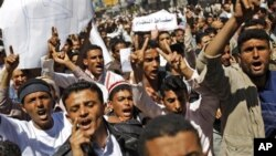 Yemeni anti-government demonstrators shout slogans during a demonstration demanding the resignation of President Ali Abdullah Saleh in Sana'a, Yemen, February 18, 2011