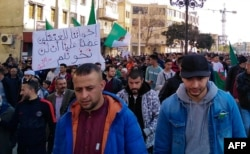 FILE - Algerians march in an anti-government demonstration in the Algerian city of Bordjab Bou Arreridj, on Feb. 14, 2020.
