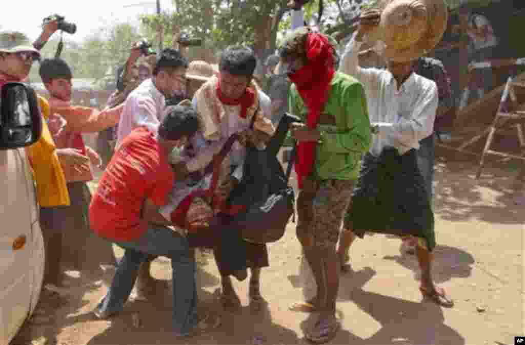 Student protesters carry a colleague who fainted during a protest in Letpadan, Myanmar, March 10, 2015.