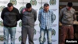 지난 6월 콜롬비아에서 현지 경찰과 미국 단속요원들의 합동 수사로 검거된 마약 밀매범들. (자료사진)