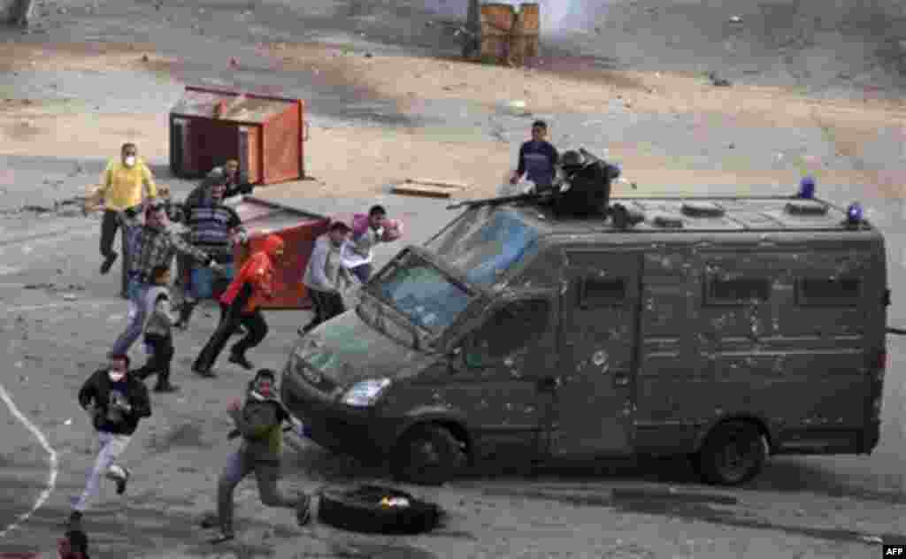 Egyptian protesters clash with riot police in Suez, Egypt Thursday, Jan. 27, 2011. Egyptian activists protested for a third day as social networking sites called for a mass rally in the capital Cairo after Friday prayers, keeping up the momentum of the co