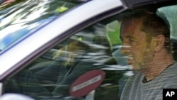 Phil Rudd, the drummer for rock band AC/DC, leaves a courthouse after being charged with attempting to procure murder in Tauranga, New Zealand, Nov. 6, 2014.