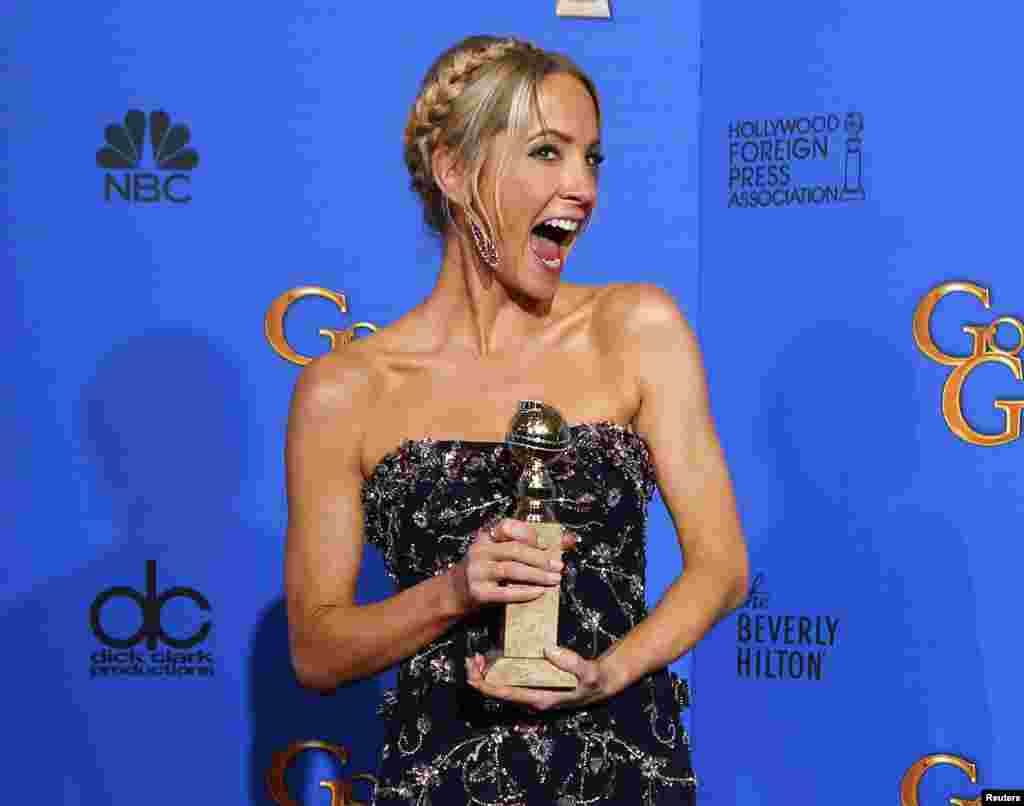 Joanne Froggatt poses with her award for Best Supporting Actress in a Series, Mini-Series or TV Movie for her role in Downton Abbey backstage at the 72nd Golden Globe Awards in Beverly Hills, California, Jan. 11, 2015.