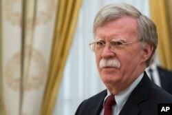 FILE - U.S. President Donald Trump's National Security Adviser John Bolton waits for the begenning of talks with Russian President Vladimir Putin in the Kremlin in Moscow, Russia, June 27, 2018.