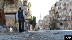 Sirijski pobunjenik u četvrti Hladijeh u pokrajini Homs.