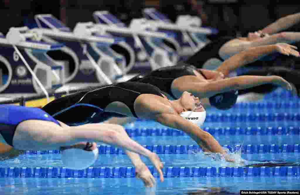 Maya Dirado dives off the starting block during the women's 200m backstroke preliminary heats in the U.S. Olympic swimming team trials at CenturyLink Center in Omaha, Nebraska.
