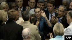U.S. Representative Gabrielle Giffords (R-TX) (C) waves to colleagues on the floor of the House of Representatives, moments after the House voted to raise the U.S. borrowing limit, in Washington in this still image taken from video August 1, 2011. Gifford